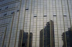 High-rise  city building in China. An interior glazed window shows the city growing in Foshan China Royalty Free Stock Photo