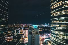 High Rise City Building during Night Time Photo Stock Photos