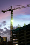 High rise concrete building construction. With a yellow crane Royalty Free Stock Photos