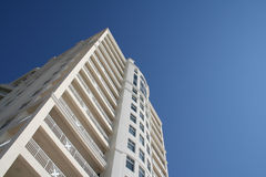 High Rise Condo. Beach front high rise condo on a sunny day against a blue sky Stock Images