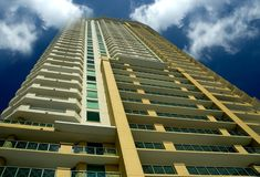 High rise condo. A downtown condominium building into the clouds Royalty Free Stock Photos