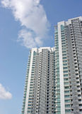 High-rise condominium blocks. 2 towers of a high rise condominium against a blue sky Stock Photo