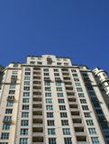 High-Rise Condominiums. High-Rise Condo building looms against a bright blue sky Royalty Free Stock Photography