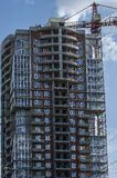 High rise construction. Completion of the construction of high-rise apartment building Stock Photography