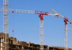 High-rise construction cranes and blue sky Stock Photos