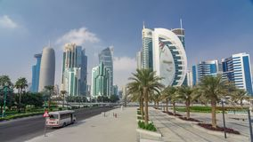 The high-rise district of Doha with traffic on intersection timelapse hyperlapse