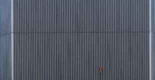 High-rise facade as a background texture. With orange warning lamp Stock Photos