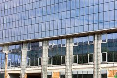 High-rise glass office building under construction with sky refl Royalty Free Stock Images