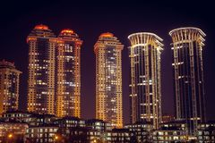 High-rise houses of a residential complex with night lighting. Expensive housing. stock photo