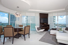 High rise living room and dining room Stock Photos