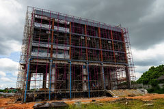 High rise luxury construction building. With iron scaffold in progress Stock Photos