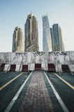 High rise modern urban buildings alongside derelict road Royalty Free Stock Images
