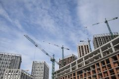 High-rise multi-storey buildings under construction. Tower cranes near building. Activity, architecture. Development process, skyscraper stock images