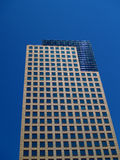 High rise office building. Low angle view of modern high rise office building with blue sky background Stock Photos