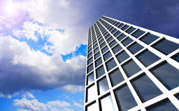 High rise office building. Low angle view of modern high rise office building with sunshine and cloudscape background Stock Photos