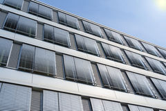 High-rise office building facade with covered windows Venetian b royalty free stock photos