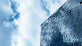 High-rise office building, glass facade, the movement of clouds in the sky, time lapse stock footage