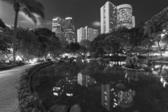 High rise office building and public park. In midtown of Hong Kong city at night stock photography