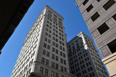 High Rise Office Buildings of 1930's Era. Buildings- 1930's High Rise Office Buildings against a Blue Sky in New Orleans, Louisiana Stock Photos