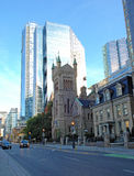 High rise with old church. Royalty Free Stock Photography