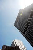 High rise tower blocks. Looking up at New York's high rise tower blocks on a bright sunny day Stock Photos