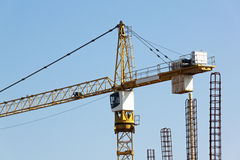 High Rise Tower Crane Operating at Construction Site Stock Images
