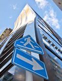 High rise tower and cross walk sign Royalty Free Stock Images