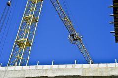 High-rise truck crane for construction and lift equipment and materials.  Royalty Free Stock Photography