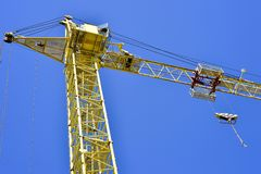 High-rise truck crane for construction and lift equipment and materials.  Royalty Free Stock Image
