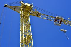 High-rise truck crane for construction and lift equipment and materials.  Stock Photo