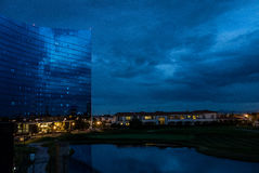 High rise with windows mirroring sky at night Royalty Free Stock Image