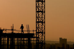 High rise worker. Silhouette of worker on a high rise construction site Stock Images