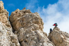 High risk by mountain climbing. Two climbers on the rocks in risk situation Stock Image