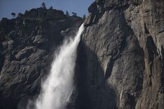 Plunging waterfall of Yosemite Falls, California. During high river flow, the famous Yosemite Falls of Yosemite National Park plunges over the granite face of Stock Images
