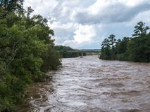 High River Water from Hurricane Florence. Flooded river from the aftermath of a hurricane royalty free stock image