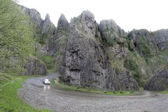 High rock cliffs of the road through Cheddar Gorge Royalty Free Stock Photo