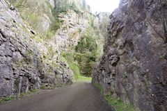 High rock cliffs of the road through Cheddar Gorge Royalty Free Stock Images