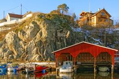 High rock on the wooden buildings Stock Images