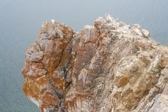 A high rocky coastline a cliff in sea a lake and fog over the water. A high rocky coastline a cliff in the sea a lake and fog over the water Royalty Free Stock Photography
