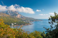 High rocky mountain by the sea, picturesque view. Of the bay stock images