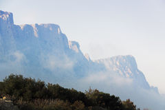 High rocky mountains in mist Stock Image