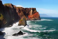High Rugged Cliffs, Madeira Coastline, Atlantic Ocean. High rugged cliffs in the Atlantic Ocean and scenic coastline of Madeira island, Portugal Stock Photos