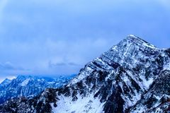 Rugged mountain in Sochi, Russia in Winter. High and rugged mountain in Sochi, Russia in Winter at a ski resort stock photography