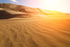 High sand dunes in the rays of  sun Royalty Free Stock Photos