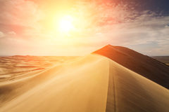 High sand dunes in the rays of  sun Stock Photography