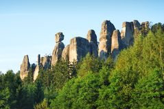 High sandstone towers rising from a forest in Adrspach Stock Image