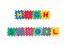 HIGH SCHOOL. Message HIGH SCHOOL from letter puzzle, isolated on white Stock Photos