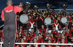 High school band. A high school marching band performing in the bleachers during an athletic event stock image