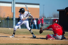 High school baseball batter takes a pitch at the knees Stock Photography