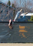High school baseball center fielder goes over the fence. Trying to save a home run Stock Photography